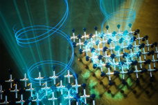 Beams of circularly polarized light (shown as blue spirals) can have two different mirror-image 要么ientations, as shown here. When these beams strike a sheet of titanium diselenide (shown as a lattice of blue and silver balls), the electrons (aqua dots) in the material take on the handedness of the light's polarization.